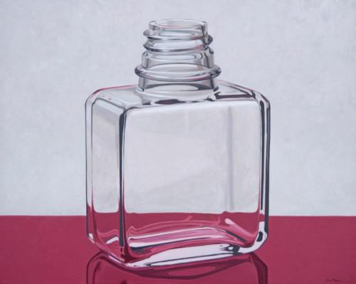 Painters medium bottle on pink surface