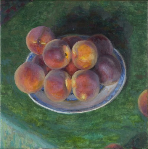 Bord perziken op groen